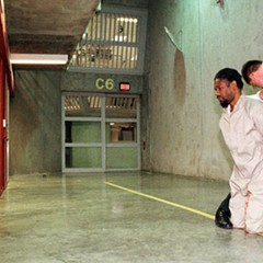 A 1998 photo of Gregory Bradford, incarcerated at Tamms, having leg shackles put on before a visit to the law library. Bradford is now serving time at Menard, one of Illinois's three maximum security prisons.
