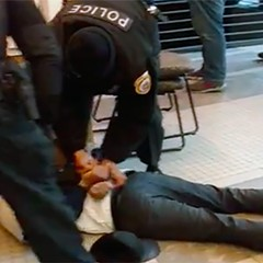 Loyola Police handcuff student Alan Campbell during a confrontation in February.