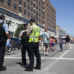 Police watch over a Pride celebration in Lakeview.