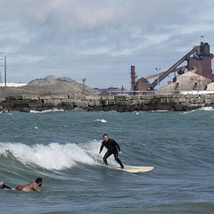Lake surfers say polluted waves are making them sick—but they love it too much to stop