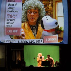 Vanessa Valliere is a QVC home shopping host in Manual Cinema's The End of TV. Below the screen are Valliere and fellow cast member/puppeteer Jeffrey Paschal.