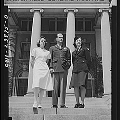 Lt. Eleanor Whalen of Chicago (Army transport nurse), Major Edward Rector (AVD flyer), and Lt. Frances Bullock of the D.C. Army Medical Center on the steps of Walter Reed in May 1943