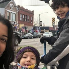 Jasmin Cardenas and her children, Catalina and Mateo, on the site of Cardenas's Butterflies, Aztec Gods and Puerquitos/Sweet Piggie Bread tour from Chicago Children's Theatre's Walkie Talkies series