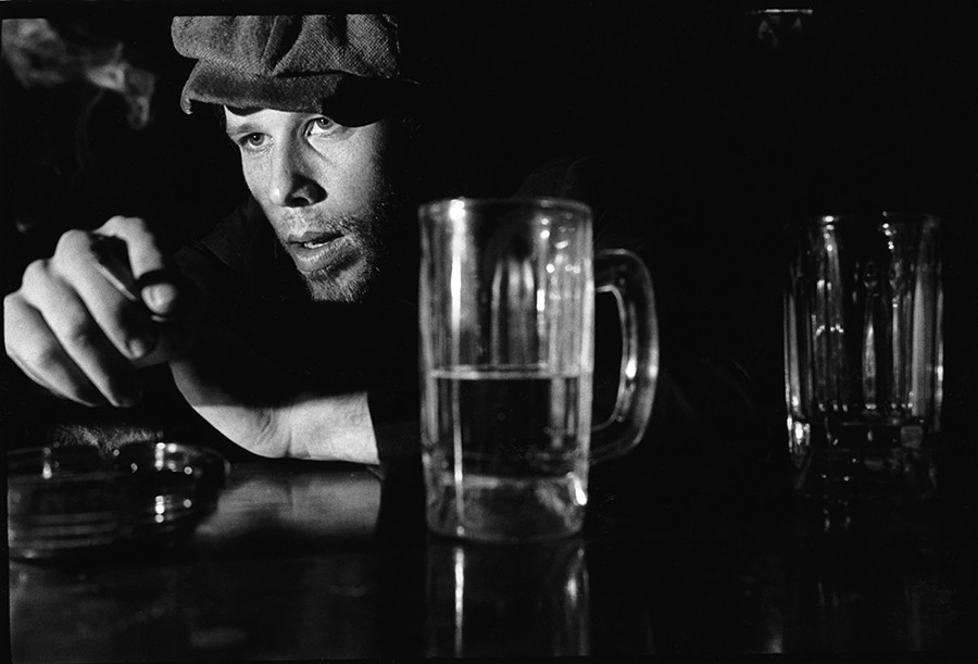 "Tom Waits - By Eric FutranFutran says: ""I heard Tom Waits on a radio concert some time in the late 70s, and my mind was blown. When I found out he was performing in Chicago I asked for an assignment to shoot his picture. When I arrived at the Quiet Night an hour before the show, I found some guy in a Tom Joad hat with his head down on the bar, cigarette in hand, nursing a beer. It was Waits."""