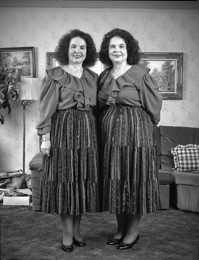 Middle-aged twins at home in Chicago - By Lloyd DeGrane