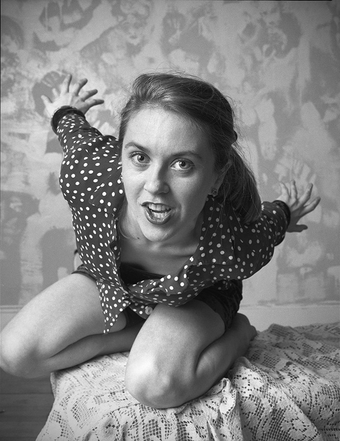 "Liz Phair in her Wicker Park apartment, 1993 - By Lloyd DeGrane for ""Greetings From Guyville: Liz Phair's Girl-o-centric Exile"" - DeGrane says: ""Her clothes were still wet. She had just come back from the laundromat, climbed up on her coffee table, and I took the photo. This was the first public photo of Liz. A month later everyone knew her name."""