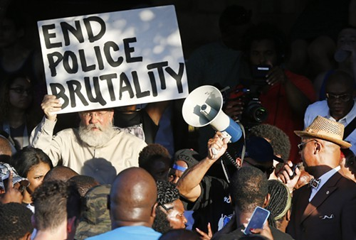 Demonstrators assemble in McKinney, Texas, to protest the violent police response to a pool party.