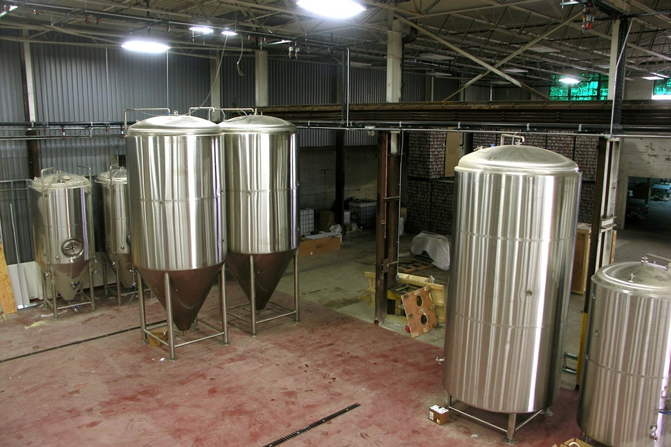 Fermenters to the left, bright tanks to the right