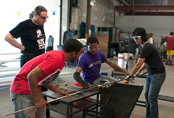 N'Kosi Barber, psychologist Brad Stolbach, Alex Harris, and glassblower Pearl Dick collaborate at Ignite Glass Studios. - ANDREA BAUER