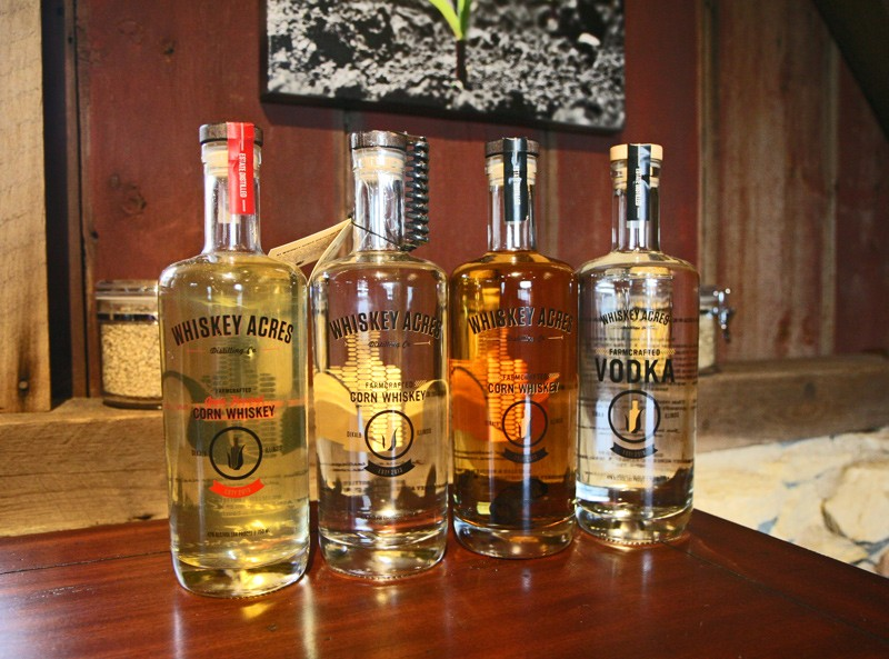 From left: apple-infused whiskey, unaged corn whiskey, corn whiskey infused with a charred oak spiral, vodka - JULIA THIEL