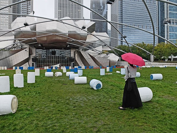 """Block listens to an early sound check for """"Sonambient Pavilion"""" in Millennium Park on September 29. - COURTESY OLIVIA BLOCK"""