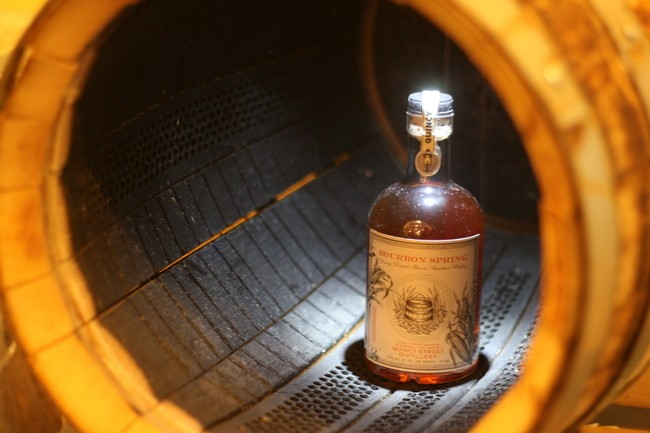Char on the inside of a barrel at the Quincy Street tasting room (with a bottle of Bourbon Spring whiskey) - JULIA THIEL