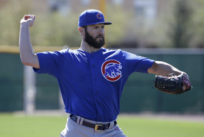 Jake Arrieta warms up in Mesa, Arizona, last month. - AP PHOTO/CHRIS CARLSON