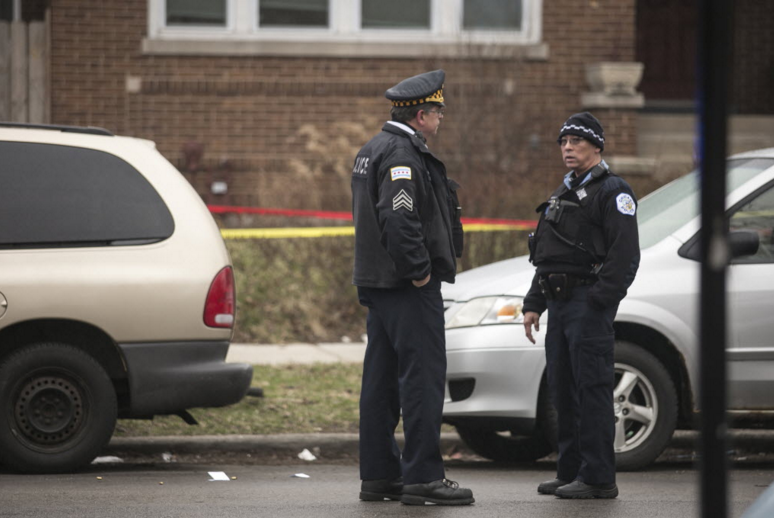 Chicago Police investigate in the 7400 block of North Ridge after an 18-year-old man was fatally shot in the head Wednesday, March 23. - ASHLEE REZIN/SUN-TIMES