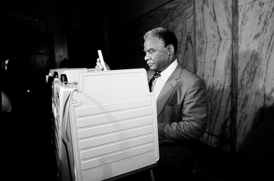 Mayor Harold Washington votes in the 1st Congressional primary in 1983. - SUN-TIMES NEGATIVE COLLECTION