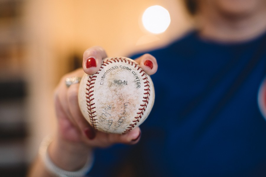 "Sherwin demonstrates the grip for a two-seam fastball with a baseball from the final Little League team she coached. ""Depending on where your thumb is on the bottom will control how it breaks,"" she says. - STEPHANIE BASSOS"