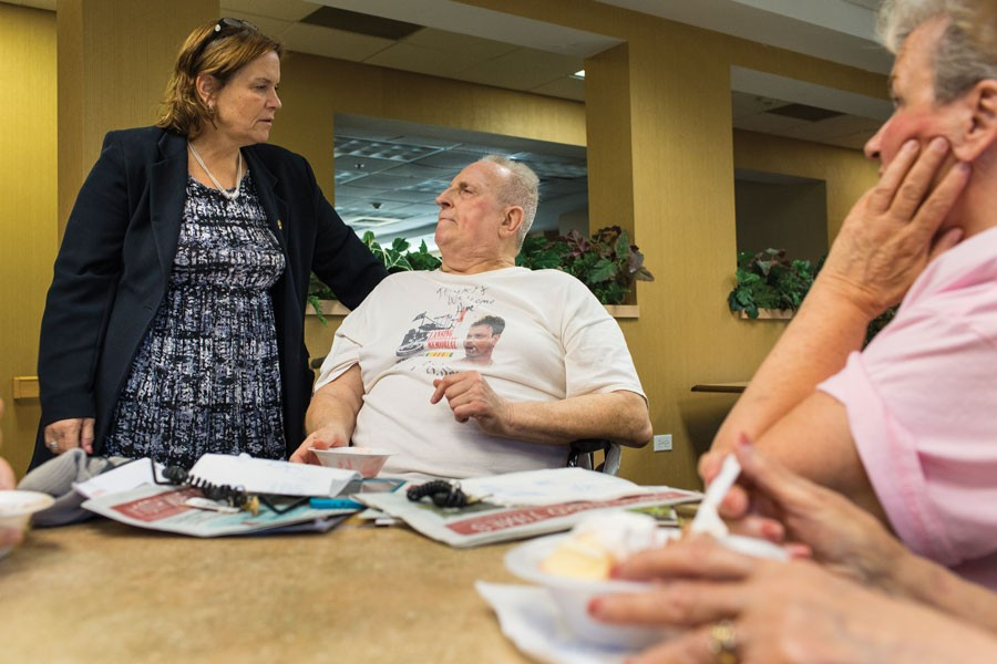 Garza with Mike Deveney, center, and other residents of a Hegewisch nursing home - MICHELLE KANAAR