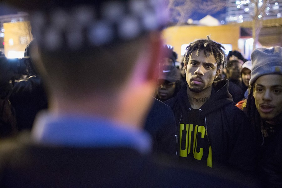 Vic Mensa (second from right) stands his ground with protesters who took to the streets of Chicago on November 24, 2015, after the release of the Laquan McDonald dashcam video. - SCOTT OLSON/GETTY IMAGES