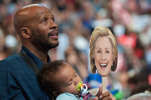 Bernard Jennings with his one-year-old son Ethan on the floor of the Democratic National Convention