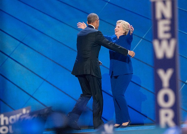 President Barack Obama and Democratic nominee for President Hillary Clinton share a hug