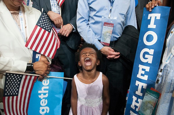 Ava Massena, 3, from Brooklyn, New York, lets out a scream during Hillary Clinton's remarks on the final night of the Democratic National Convention