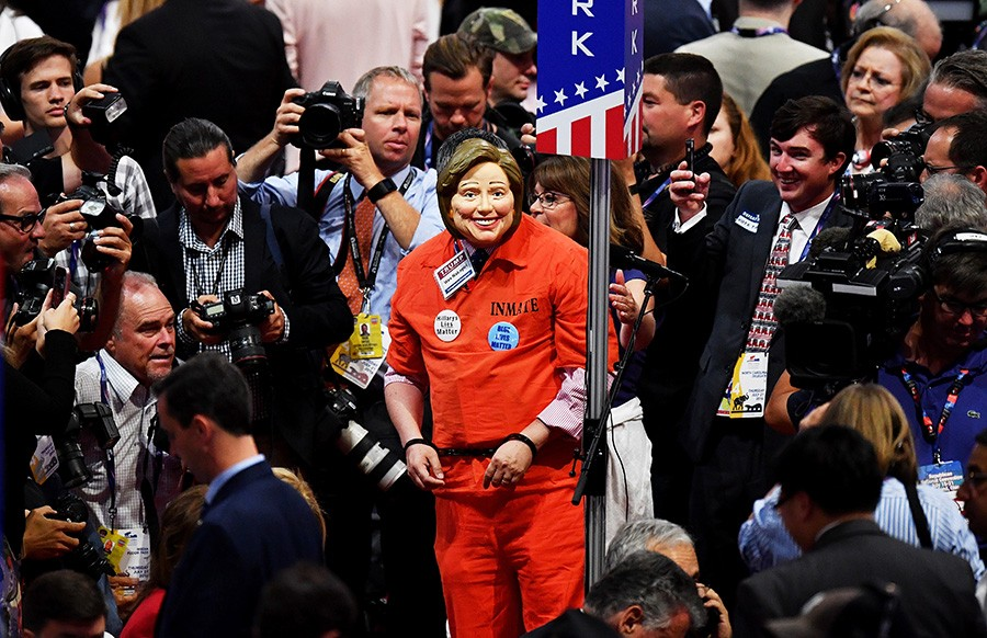 Reporters crowd around an anti-Clinton activist at the Republican National Convention in July. - JEFF J MITCHELL / GETTY
