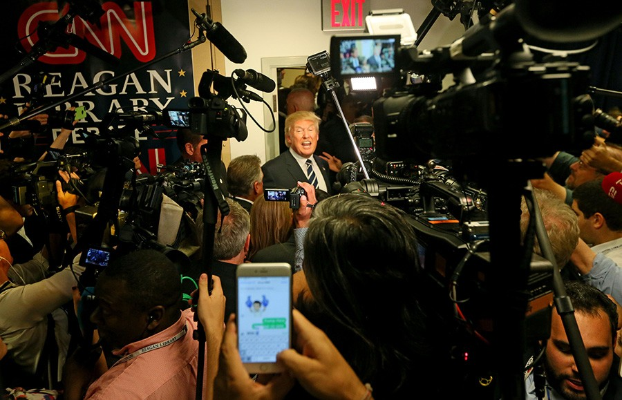 Trump soaks up the media spotlight last September. - SANDY HUFFAKER