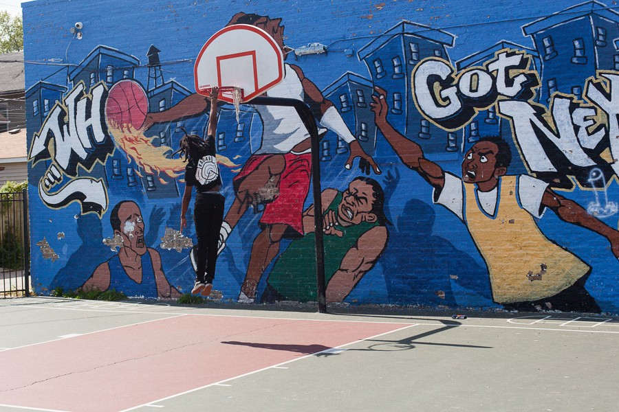 "Saba on the court next to the Westside Health Authority: ""Everybody was just trying to work to get to go to the NBA. That was it—we either gonna rap, or we going to the NBA. So pick one."" - DANIELLE A. SCRUGGS"