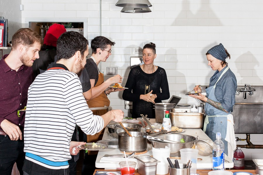 Elizabeth's staff meals range from sauteed shrimp one night to the tacos pictured. Chef-owner Iliana Regan (far right) views the meals as a chance to sharpen skills. - NICK MURWAY