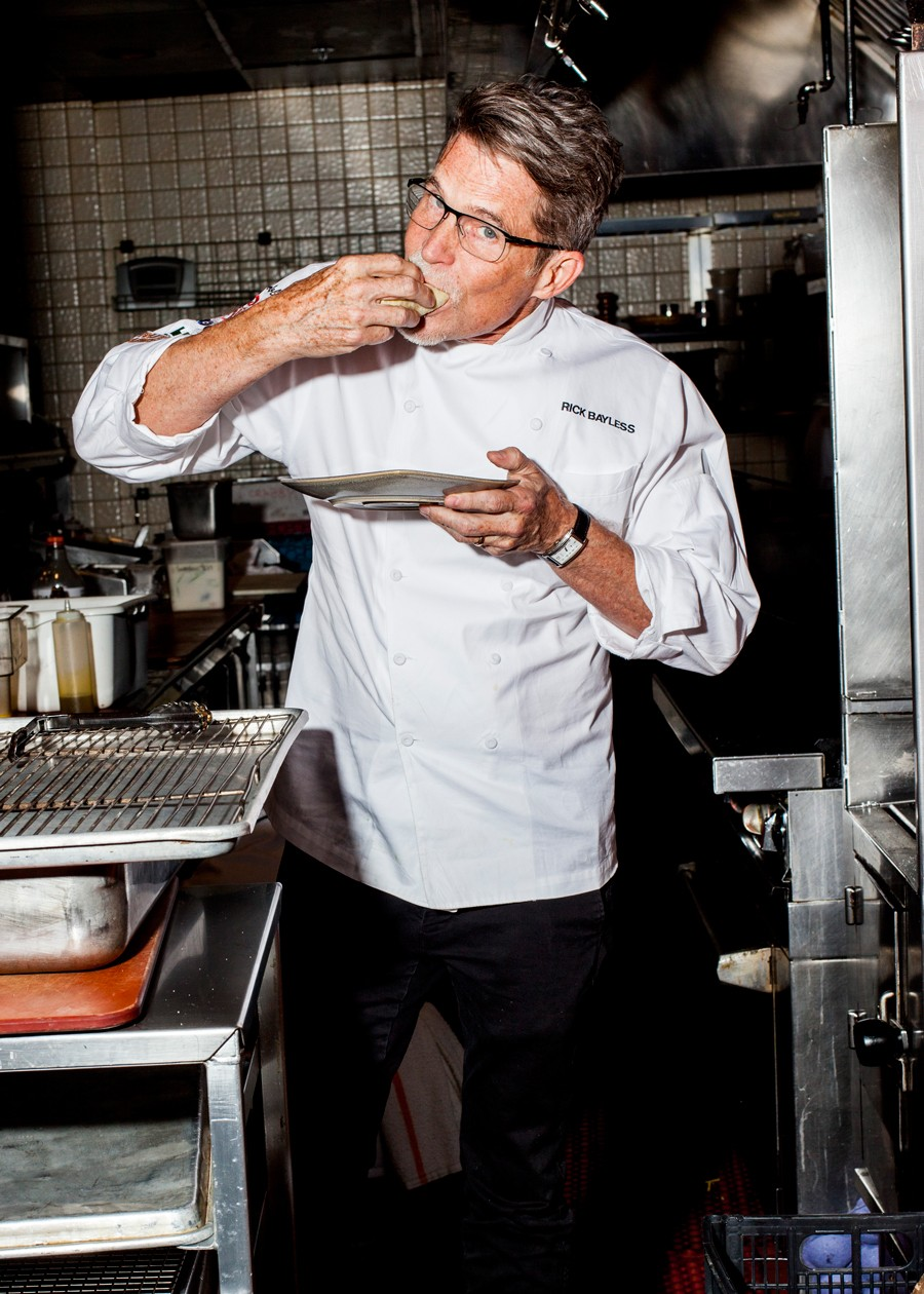 Rick Bayless eats his Emergency Tacos one plate at a time. - NICK MURWAY