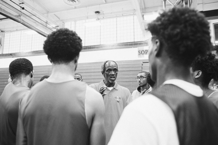 Craig Hodges speaks to the players he coaches at Rich East High School. - DANIELLE A. SCRUGGS