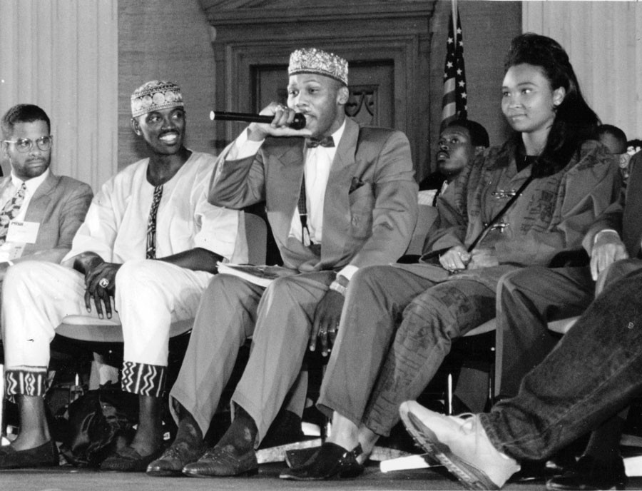 "In September 1992, Craig Hodges (seated second from left) joined rappers Prince Akeem (pictured holding the microphone, second from right) and May May on Youth Empowerment Day at Operation PUSH headquarters. Hodges is not a Muslim but says that he ""studies all religions."" - SUN-TIMES PRINT COLLECTION"