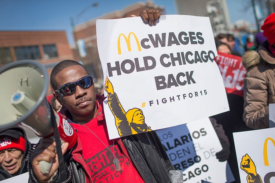 Demonstrators demanding an increase in the minimum wage protest in front of a Chicago McDonald's in April. - SCOTT OLSON/GETTY IMAGES
