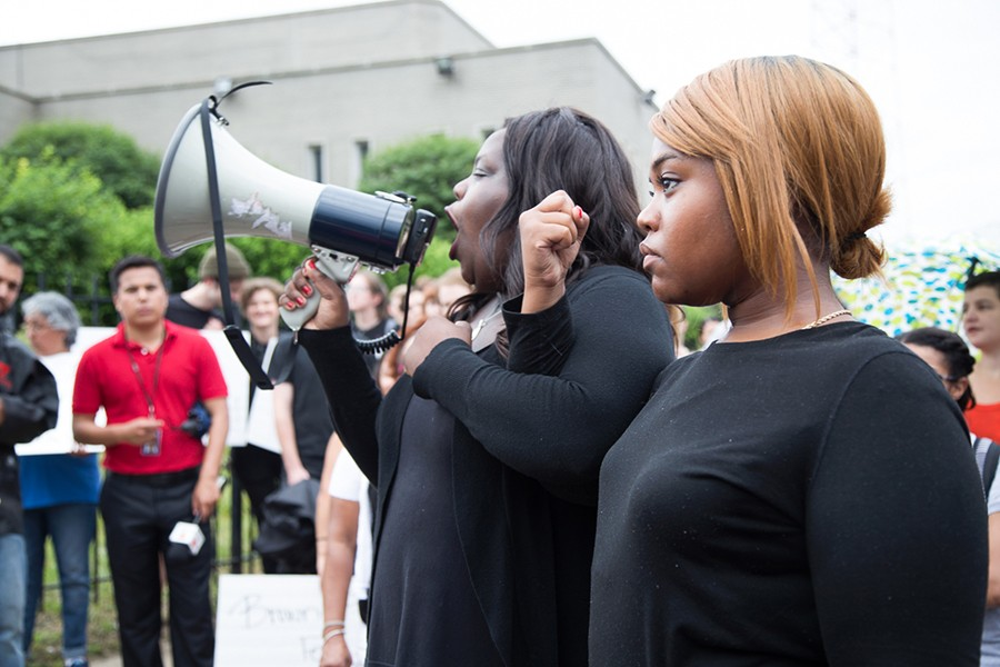 Chicago Call to Action Protest organizers Imani, left, and Kristen gave safety instructions before a march that shut down the Dan Ryan Expressway in July, showing how to lock arms so that the police could not easily break the group apart. - SUNSHINE TUCKER