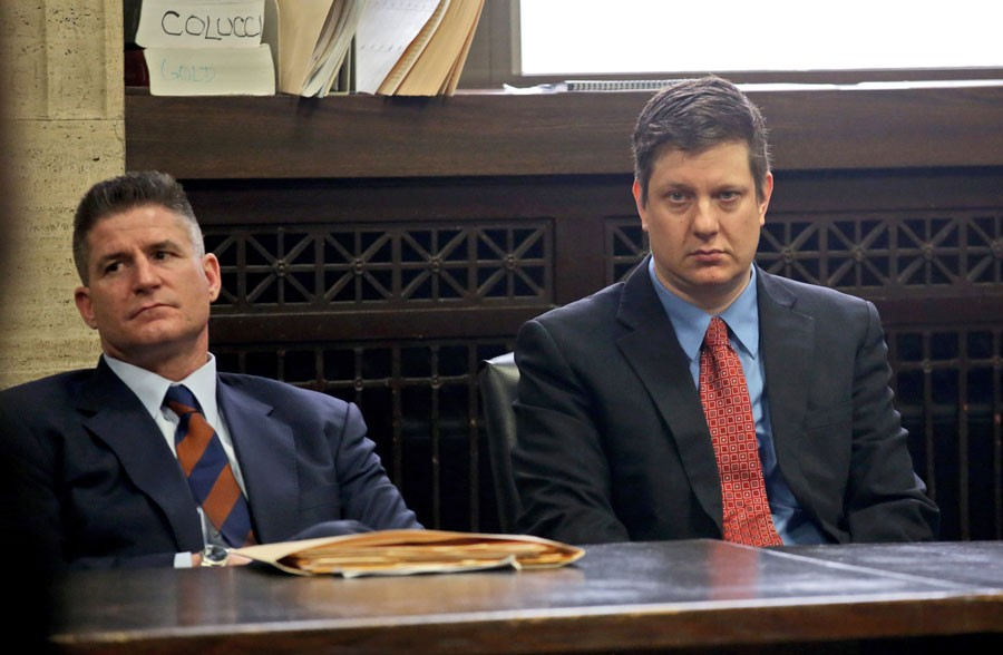 Herbert with his client Jason Van Dyke at the Leighton Criminal Courthouse in March 2016. Herbert argues that Van Dyke's shooting of Laquan McDonald was justified, and accuses city officials of sacrificing Van Dyke to save their own political skins. - NANCY STONE/POOL/CHICAGO TRIBUNE