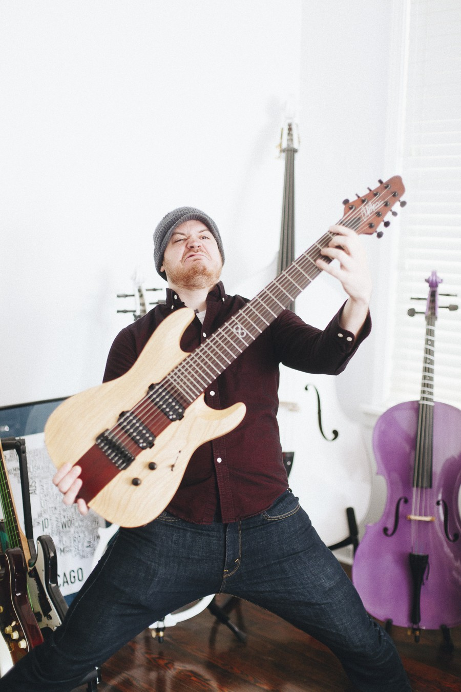 Rob Scallon demonstrates an impractical way to hold his Chapman Guitars signature model eight-string. - DANIELLE A. SCRUGGS