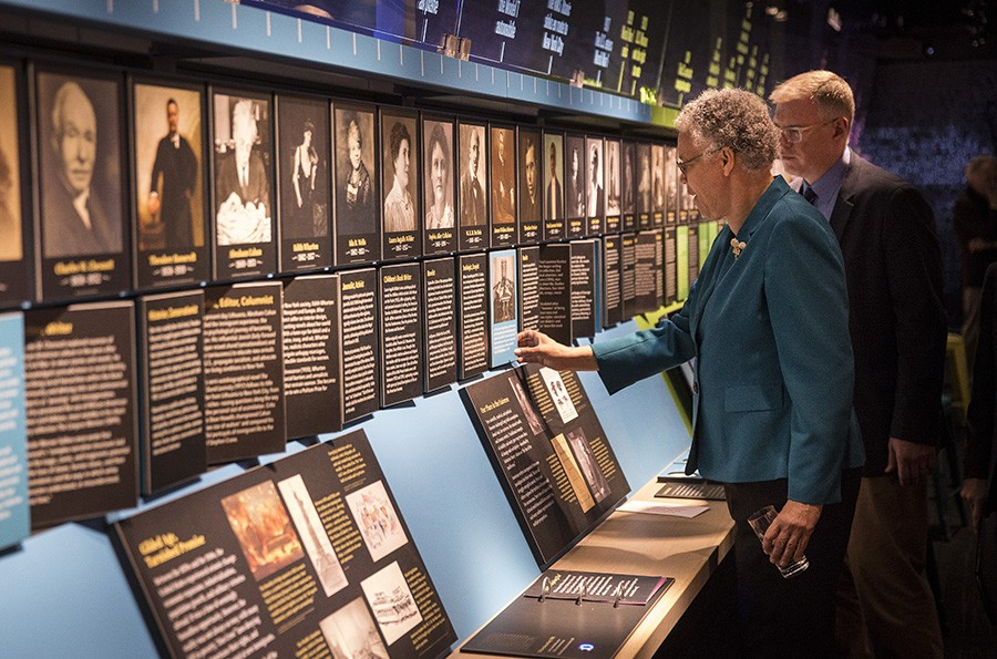 Cook County Board president Toni Preckwinkle checks out the exhibits at the American Writers Museum with the museum's director of operations, Christopher Burrow. - RICH HEIN/SUN-TIMES