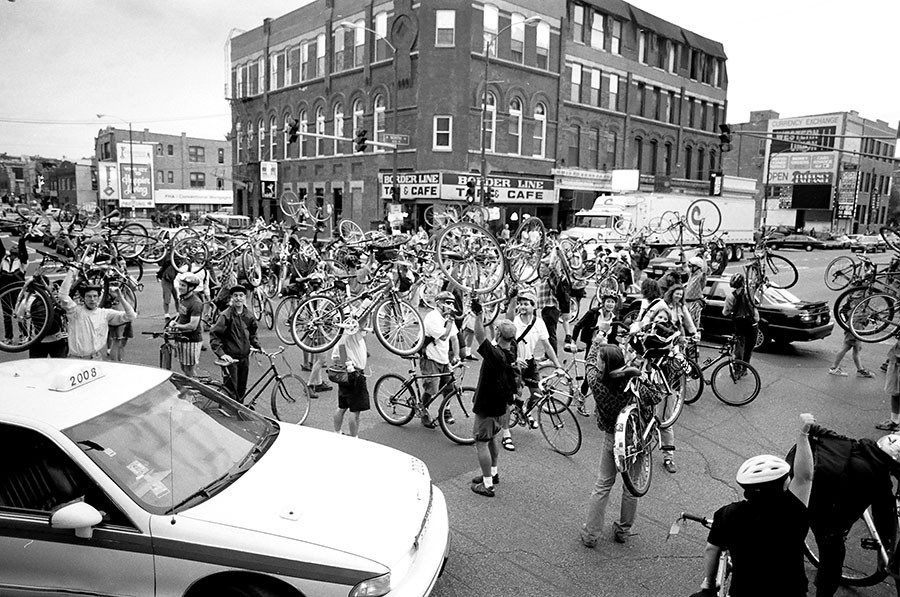 "Critical Mass riders execute a ""Chicago Holdup"" at the Wicker Park ""Crotch"" during the first monthly ride on September 5, 1997. - JAMES WARDEN"