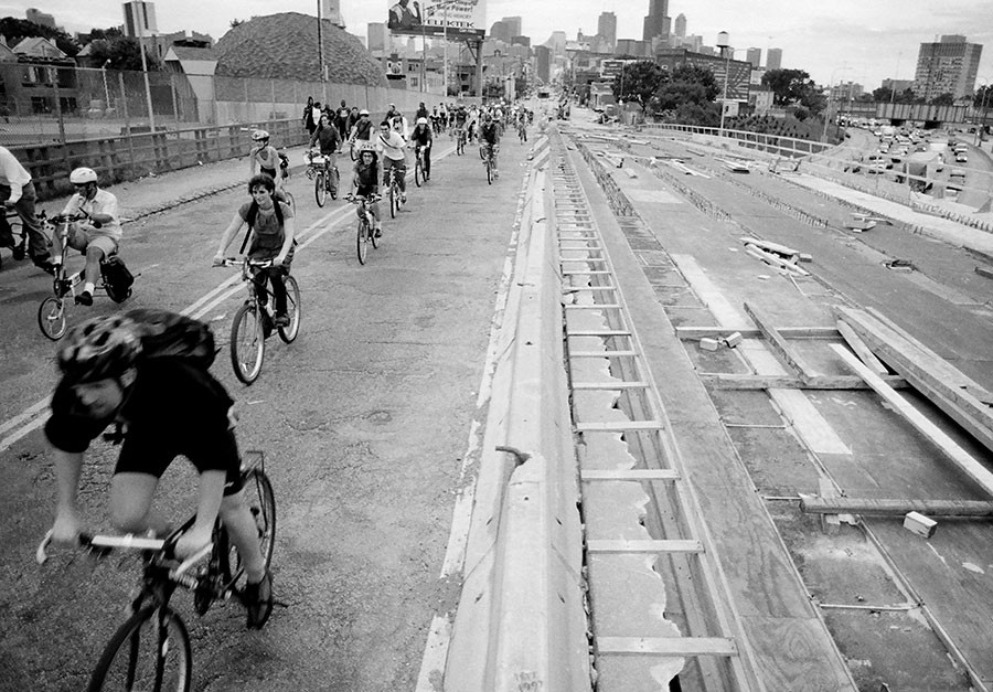 Chicago Critical Mass riders cross the Kennedy Expressway on Milwaukee Avenue during the first monthly ride on September 5, 1997. - JAMES WARDEN