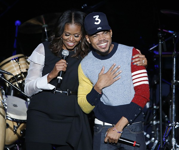 Michelle Obama and Chance, at the Obama Foundation Summit concert - CHARLES REX ARBOGAST