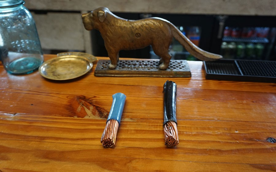 Two of the copper wires that were cut. - CHICAGO READER/ASHLEY MIZUO