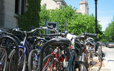 Bike racks, like these in Hyde Park, are often jam-packed around the city. - JOHN GREENFIELD