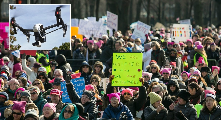 Proposed legislation would allow expanded use of drones (inset) to monitor large public events like the Women's March this past January. - SUN-TIMES