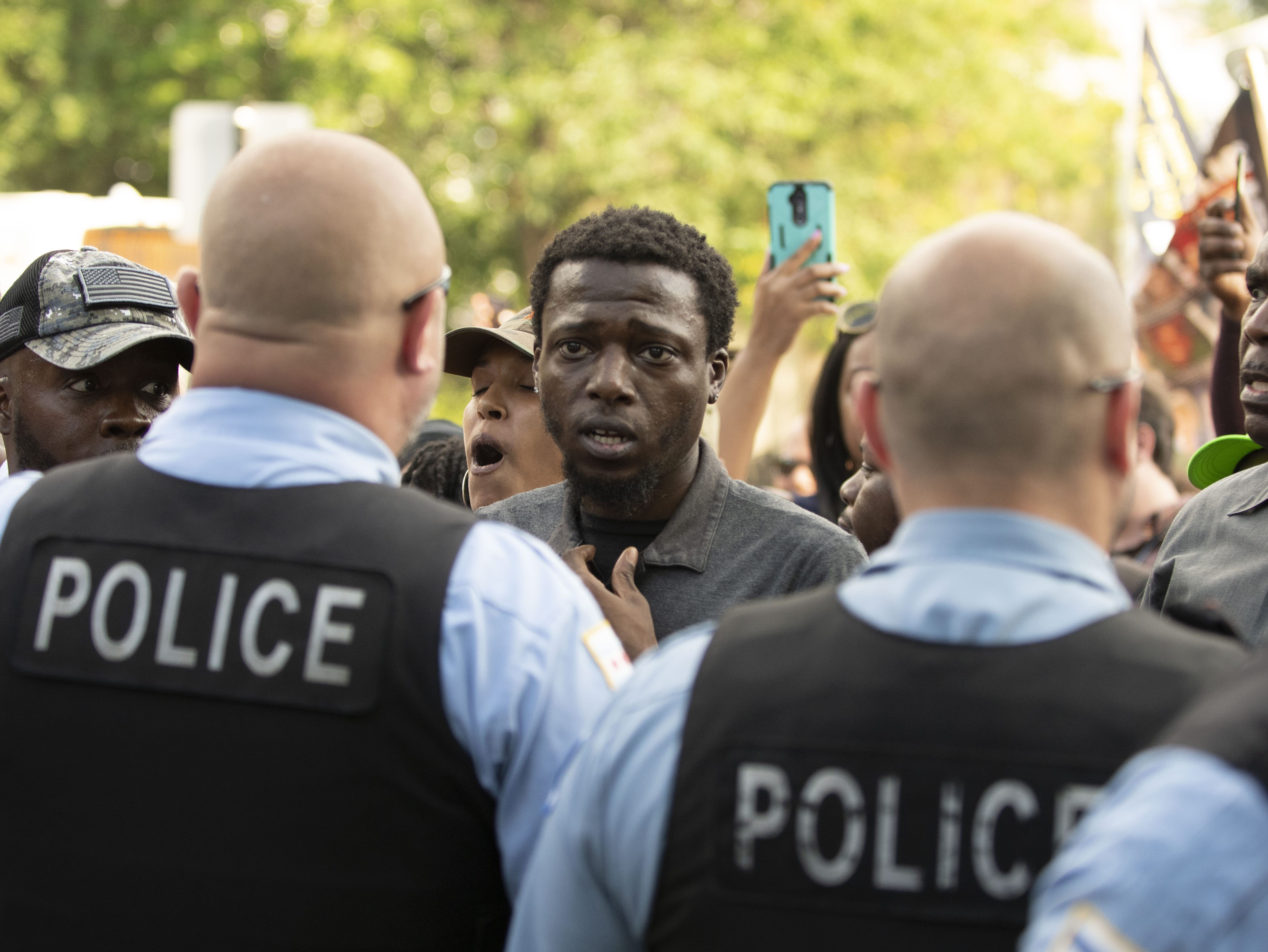click to enlarge Police and protesters confront