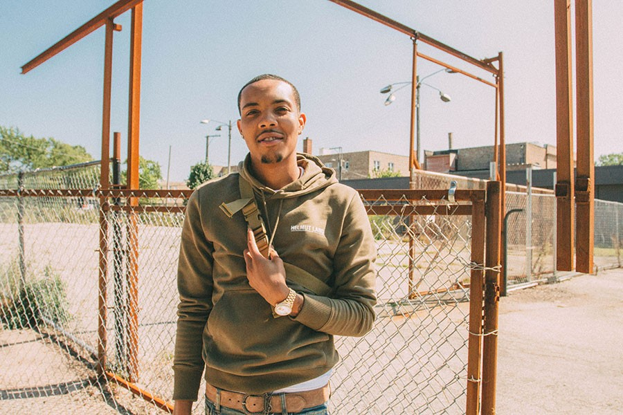 G Herbo on the campus of Anthony Overton Elementary, with the school's former Child Parent Center in the background - THOUGHTPOET