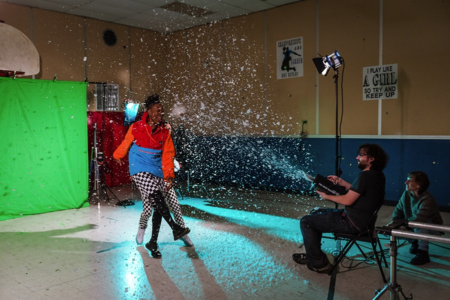 Nat Alder of New Trash blows fake snow at Mother Nature. Lighting director Anastasia Mikolyuk is at far right. - ALLISON ZIEMBA