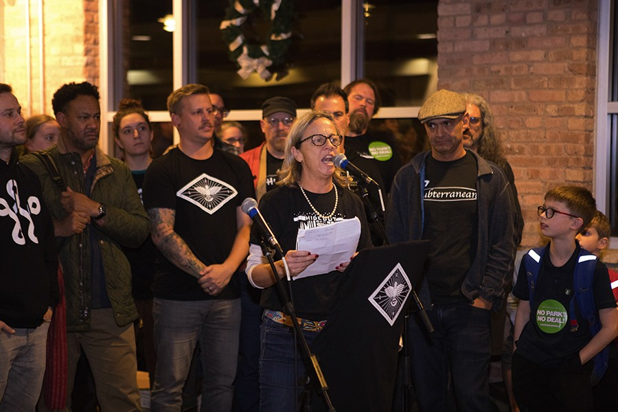Hideout co-owner Katie Tuten addresses the crowd at the November 29 CIVL meeting. - KRIS LORI