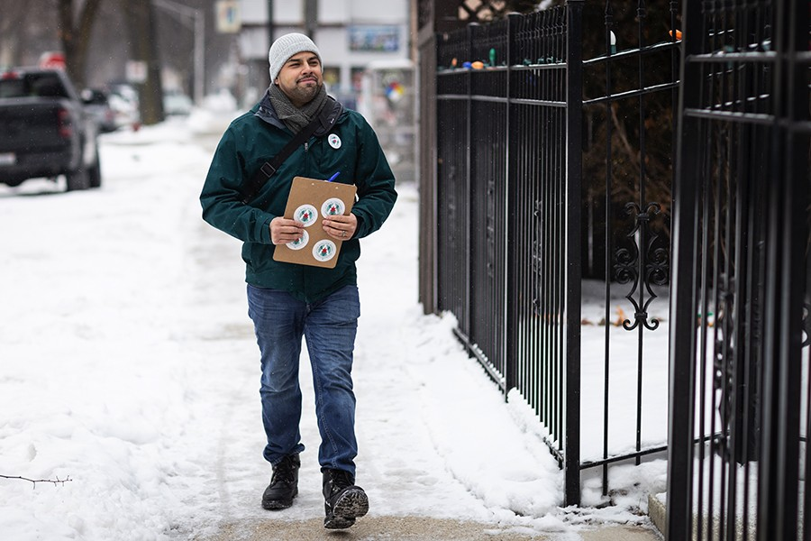 Aldermanic candidate Andre Vasquez gathers signatures for his ballot petition in January. - DEANA RUTHERFORD