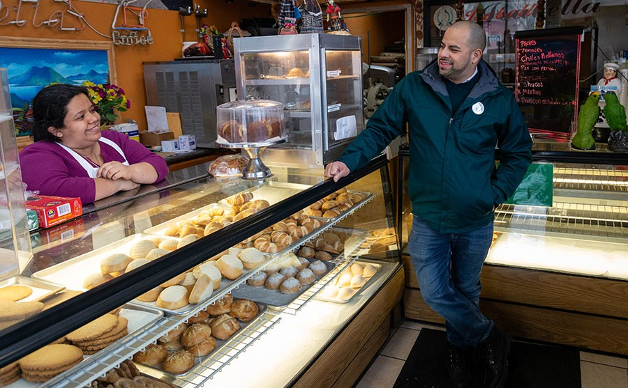Andre Vasquez talks politics with a potential constituent at Isabella Bakery (1659 W. Foster) in January. - DEANA RUTHERFORD