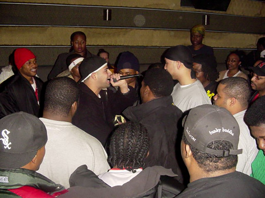 Vasquez on the mike at a rap battle in 2003 - COURTESY OF ANDRE VASQUEZ